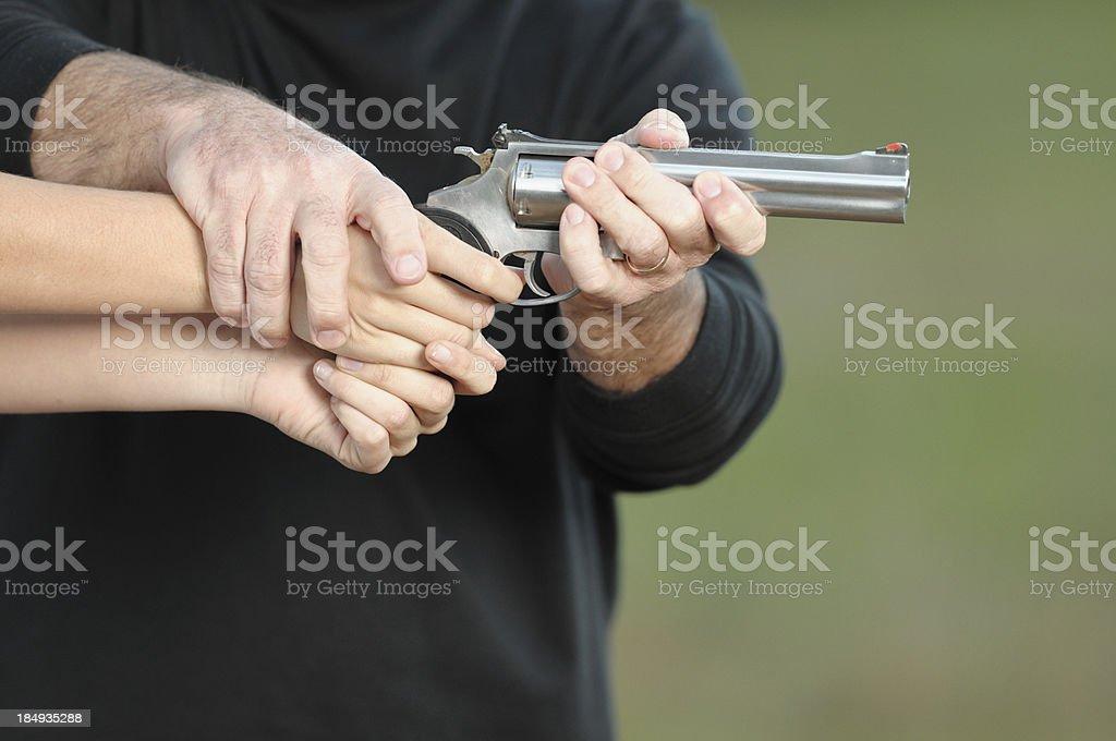 Training someone how to shoot handgun stock photo