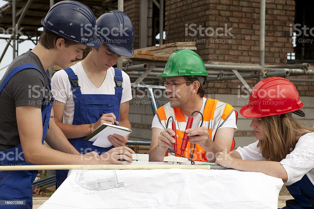 Training to be a electrician. Trainee making notes. royalty-free stock photo