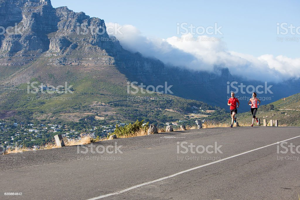 Training together - out on a morning run stock photo
