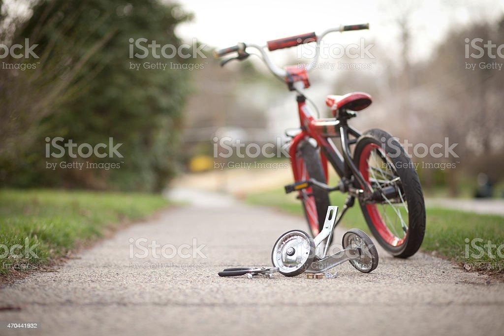 Training wheels taken off child bicycle stock photo