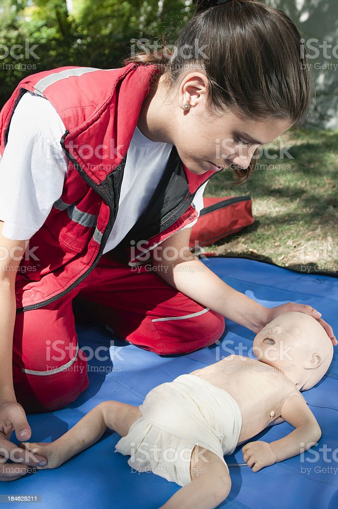 CPR training with an infant dummy royalty-free stock photo