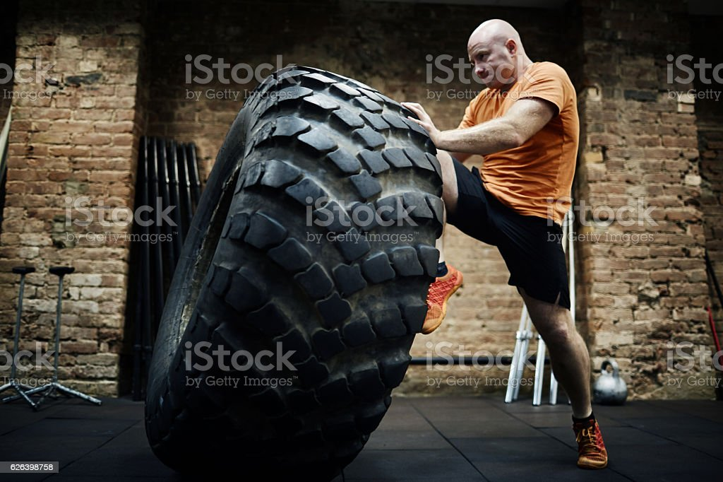 Training with heavy tire stock photo