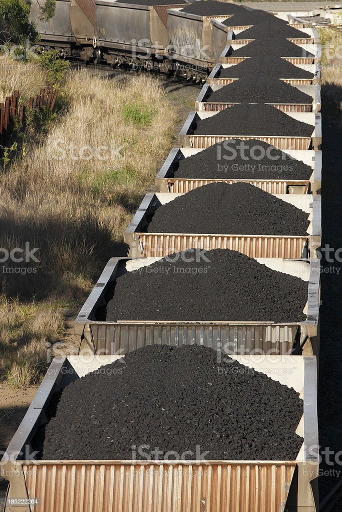 Trainload of black coal heads to port stock photo