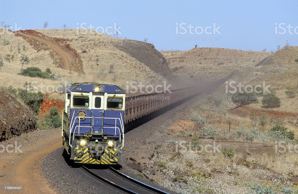 Trainload of iron ore heads to port stock photo