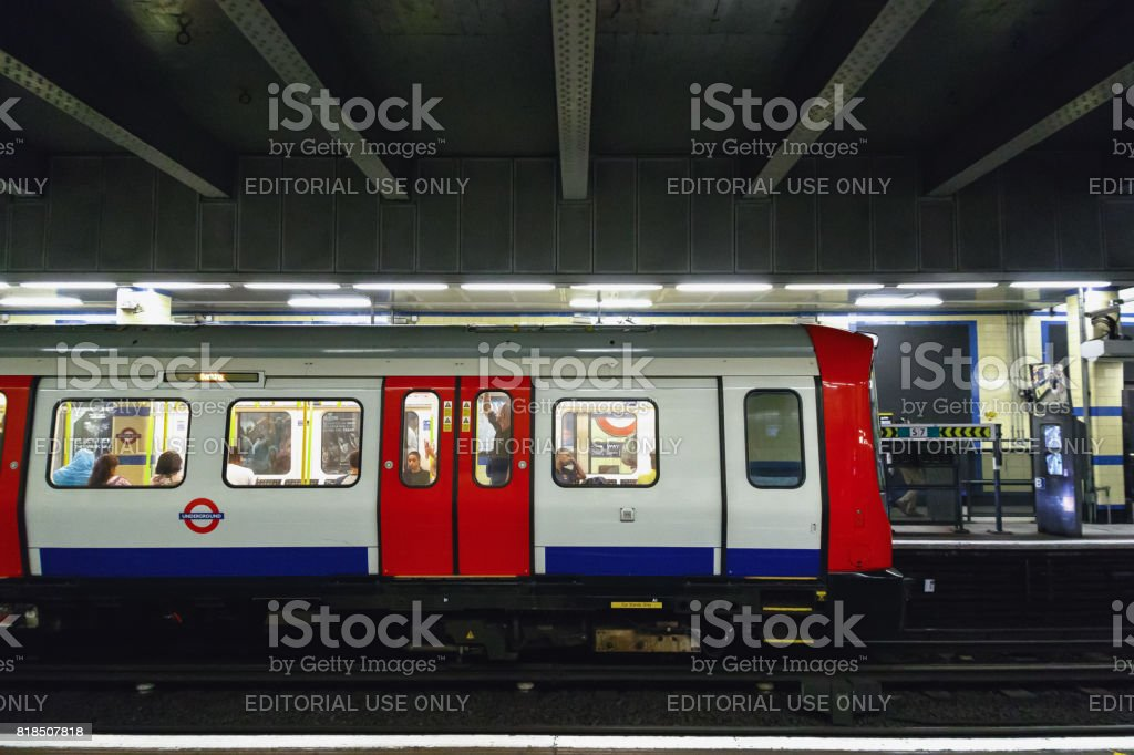 Trains about to depart from Aldgate East tube station stock photo