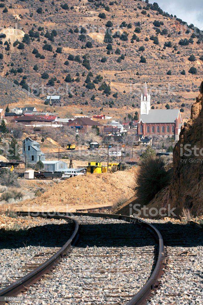 Trains and St. Mary's Church in Virginia City, Nevada stock photo