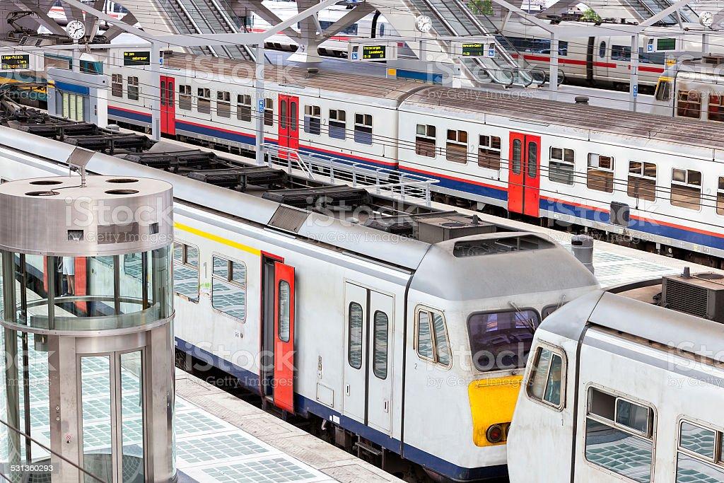 Trains on Platform in Modern Railway Station stock photo