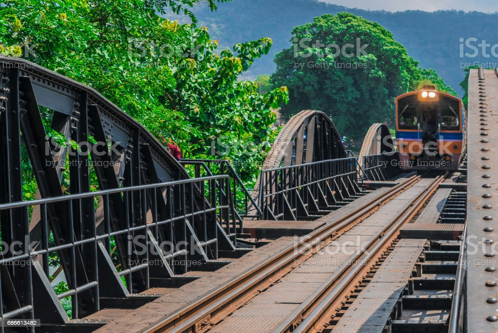 trains run across the River Kwai Bridge. stock photo
