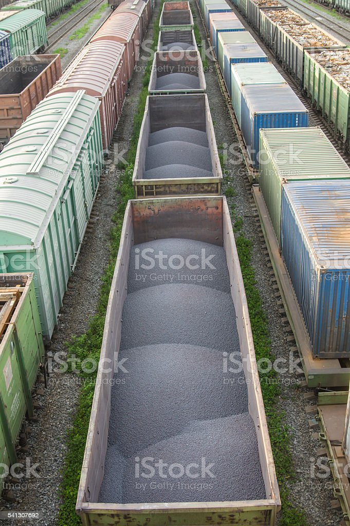 trains with industrial goods stand on the rails stock photo
