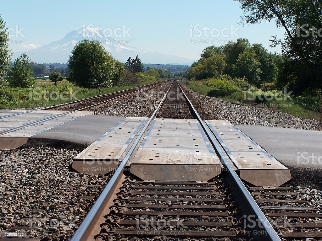 Traintracks with Mountain in distance stock photo