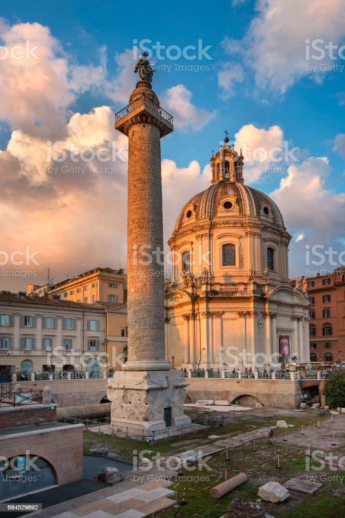 Trajan's Column and Santa Maria di Loreto Church in the Evening, Rome, Italy stock photo