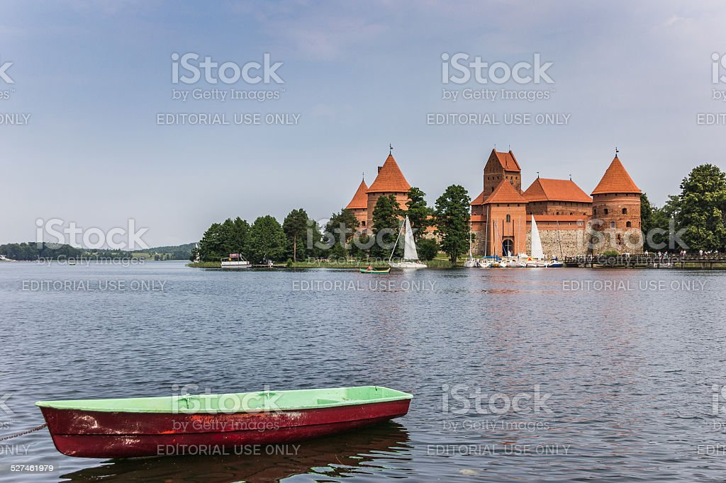 Trakai red brick castle with a boat in front stock photo
