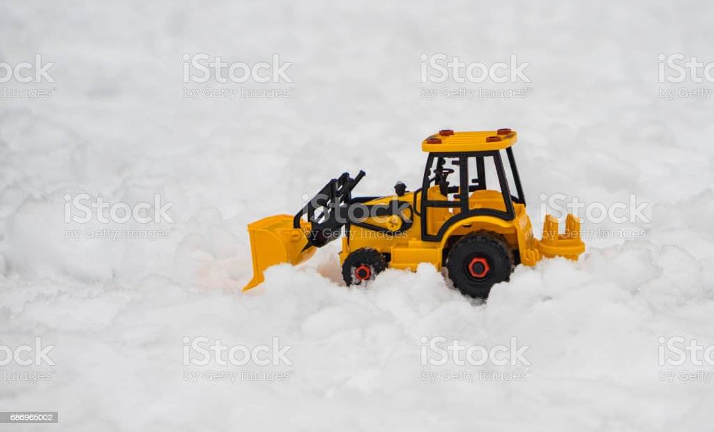 Traktor toy in deep snow stock photo