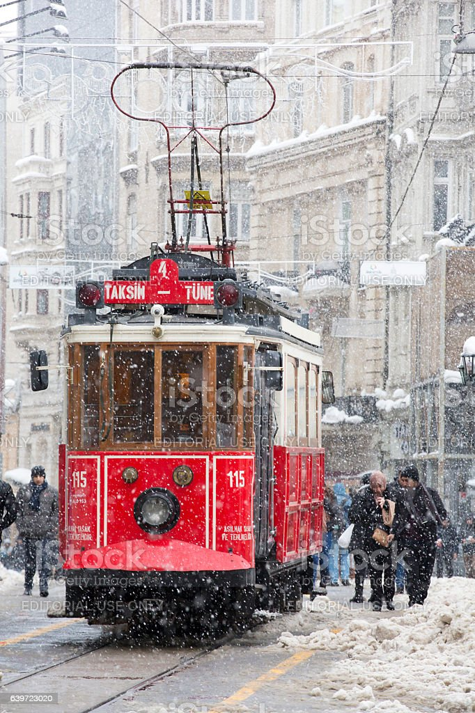 Tram and people under snow rain at Istiklal Street stock photo