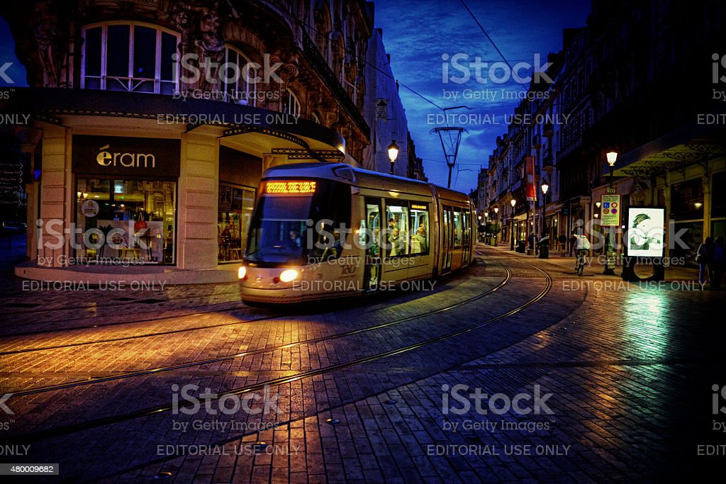 Tram at dusk in Orleans France stock photo