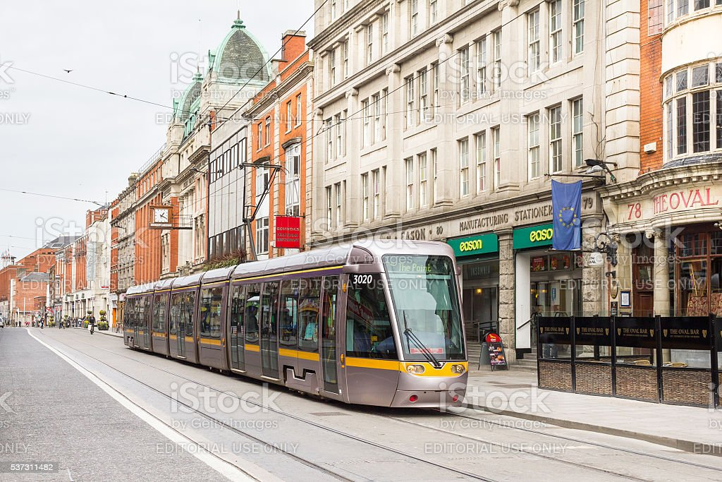 Tram crossing a road in the centre of Dublin, Ireland stock photo