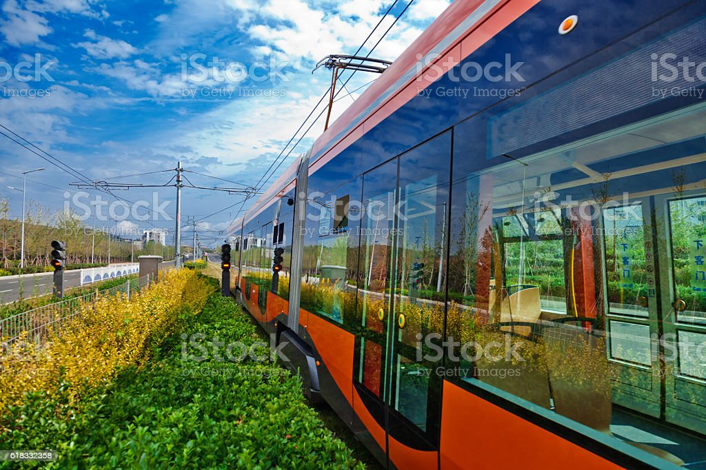 tram driving on the street stock photo