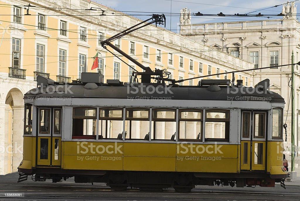 Tram in Comercio Place, Lisbon. stock photo
