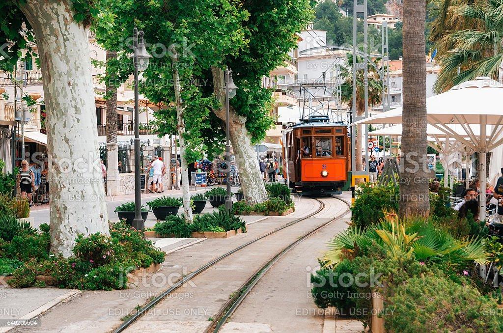 Tram on the promenade of Port de Soller. стоковое фото