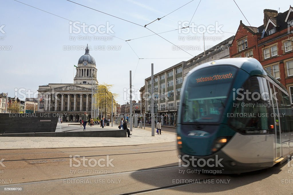Tram passing Nottingham Council House in The Old Market Square stock photo