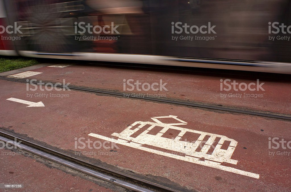 Tram passing speed along the crosswalk royalty-free stock photo