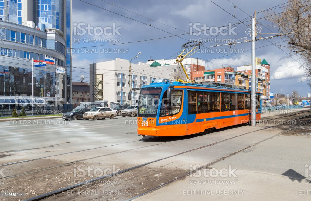 Tram rides on street in summer sunny day stock photo