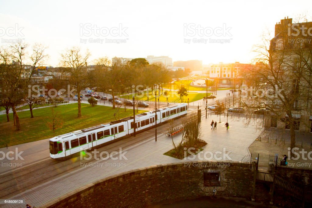 Tram rides through the city center of Nantes, France stock photo