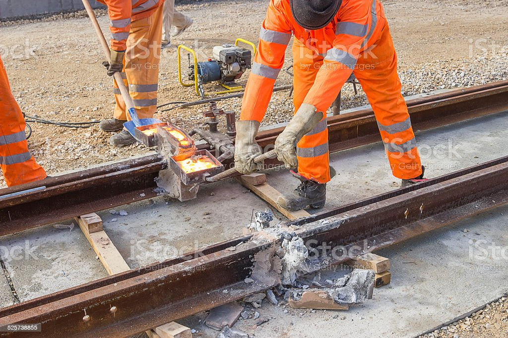 Tram track construction site, tracks being joined stock photo