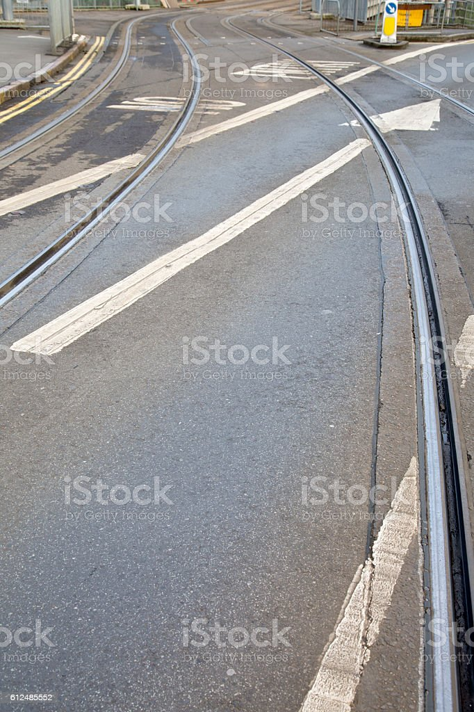 Tram Tracks and Arrow Sign on Street in Nottingham, England stock photo