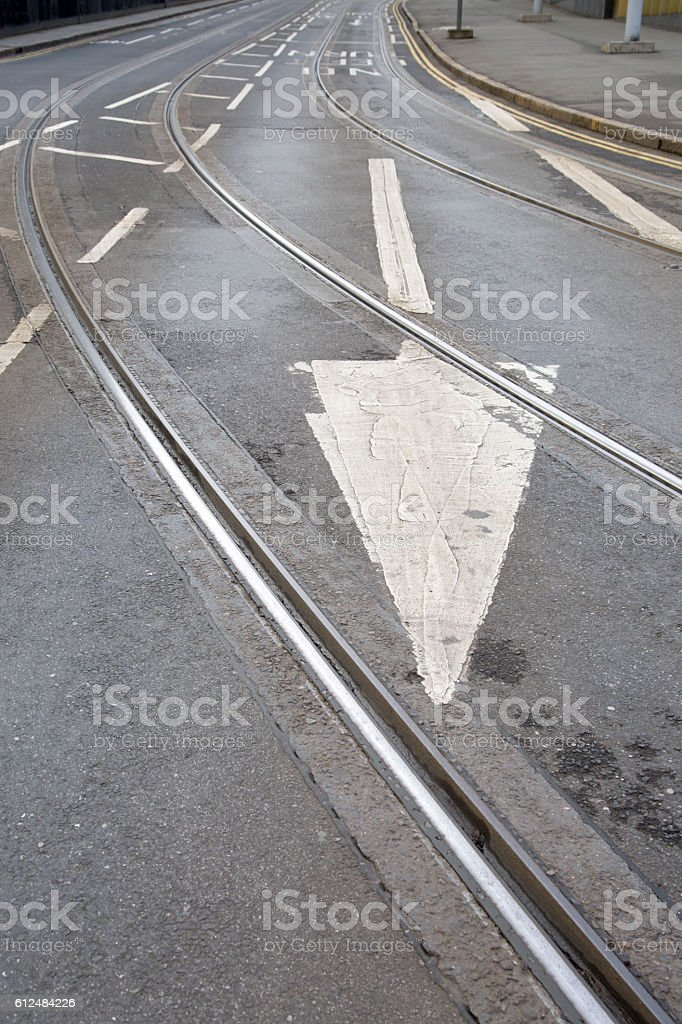 Tram Tracks and Arrow Sign on Street in Nottingham stock photo