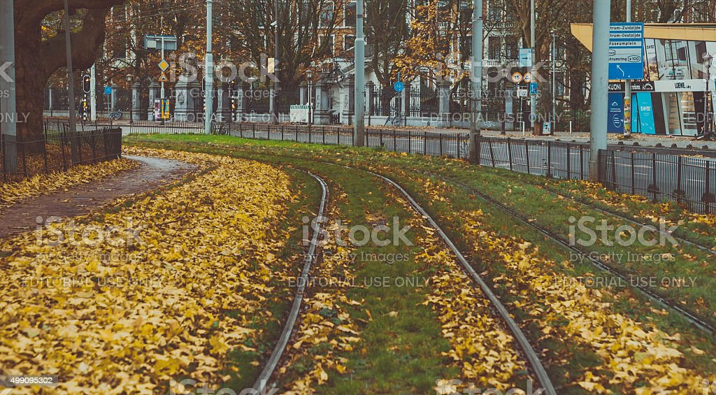 Tram Tracks from Amsterdam Town Square during Autumn stock photo