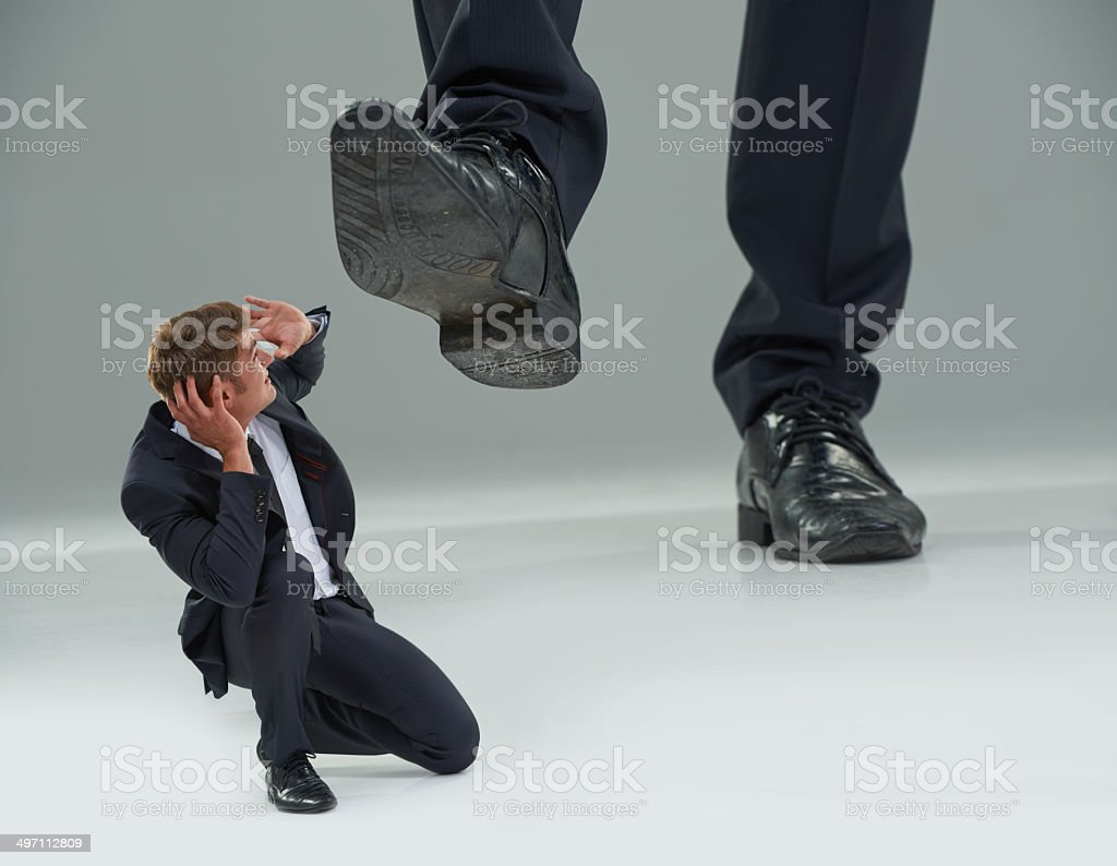 Trampled by The Man! stock photo