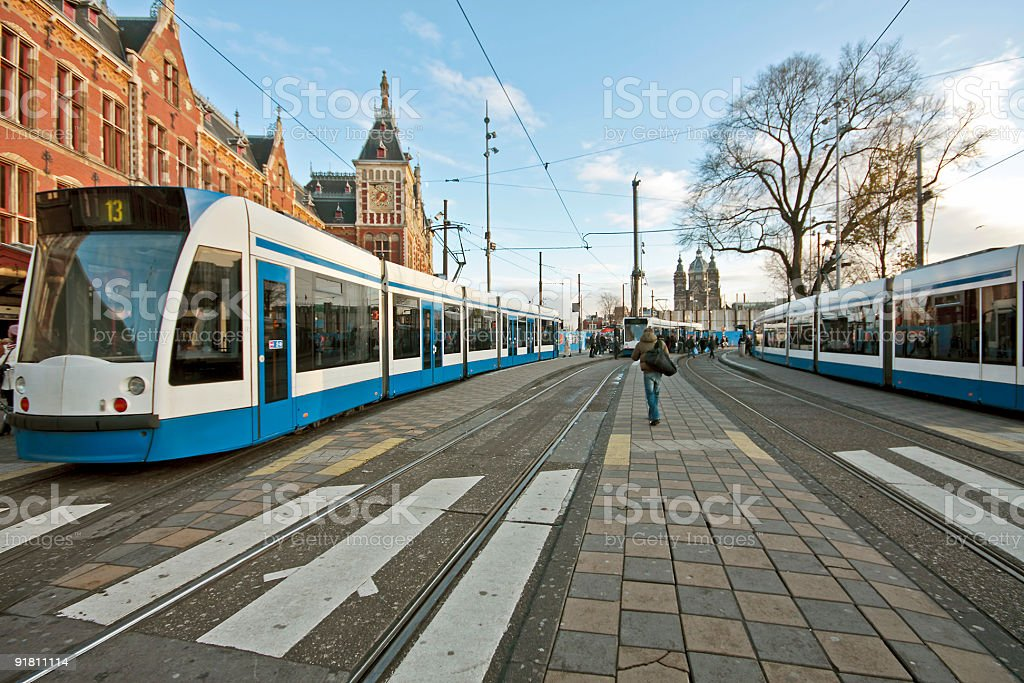 Trams at the main station in Amsterdam Netherlands stock photo