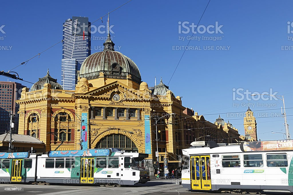 Trams pass in front of Flinders Street Station, Melbourne stock photo