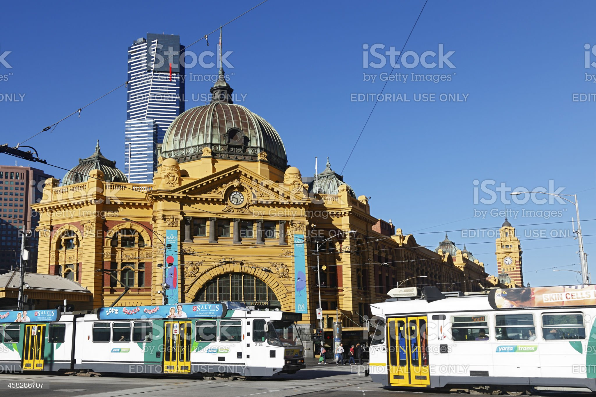 Trams pass in front of Flinders Street Station, Melbourne royalty-free stock photo