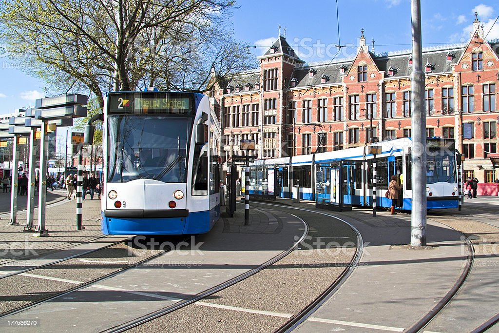 Trams waiting at Central Station in Amsterdam the Netherlands stock photo