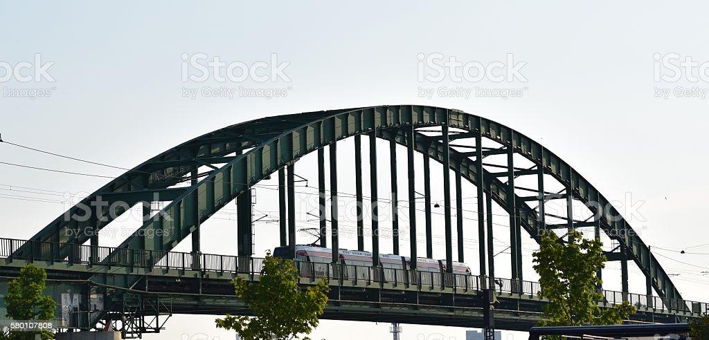 Tramway on the old metal railway bridge stock photo