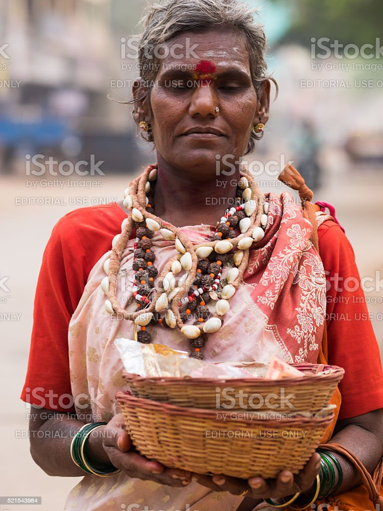 Trangender man offering blessings in Hospet, Southern India stock photo