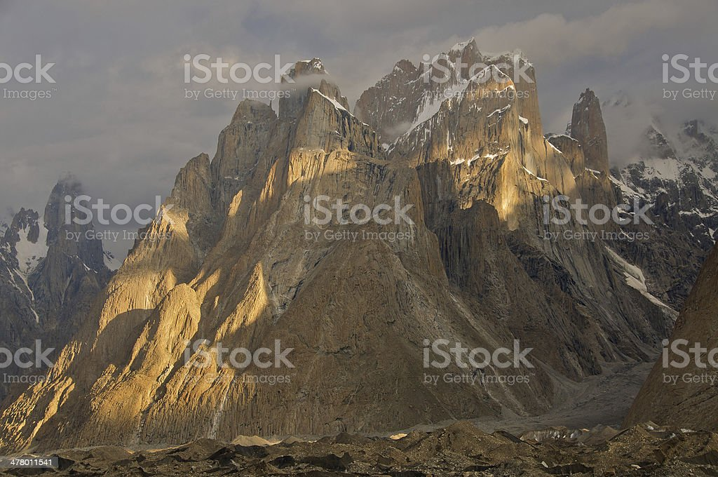 Trango Towers in clouds stock photo