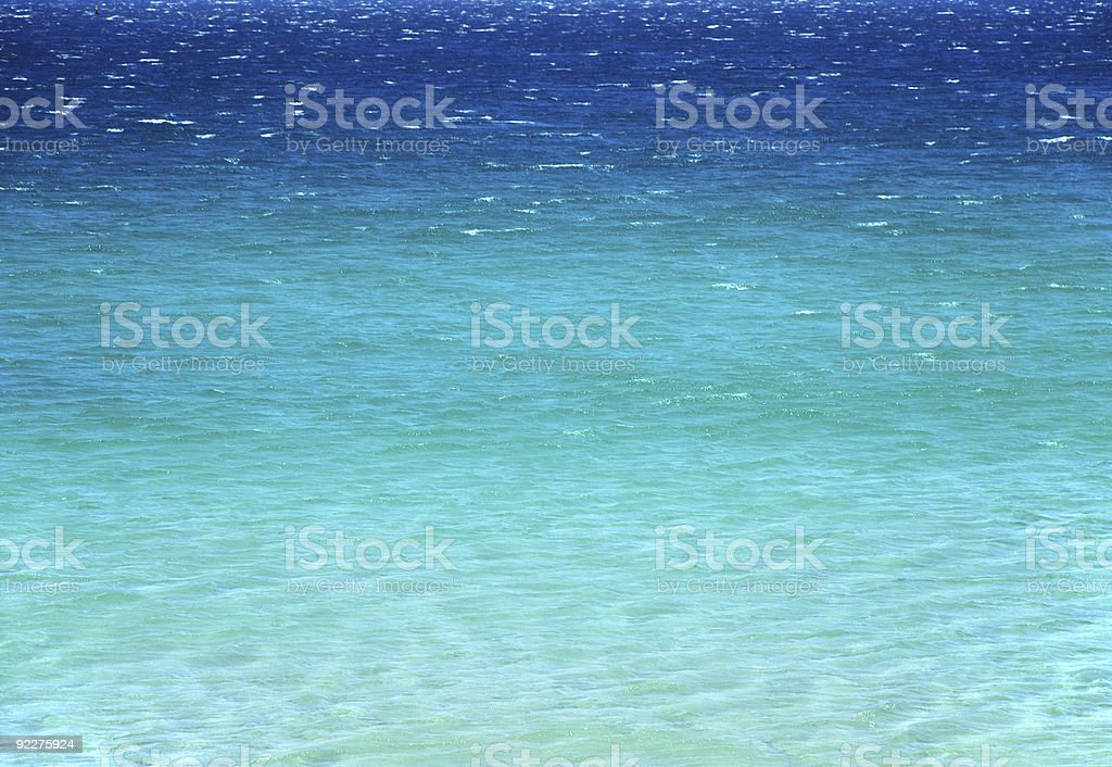 Tranquil azure sea surface with transfer of colourr, clear water royalty-free stock photo