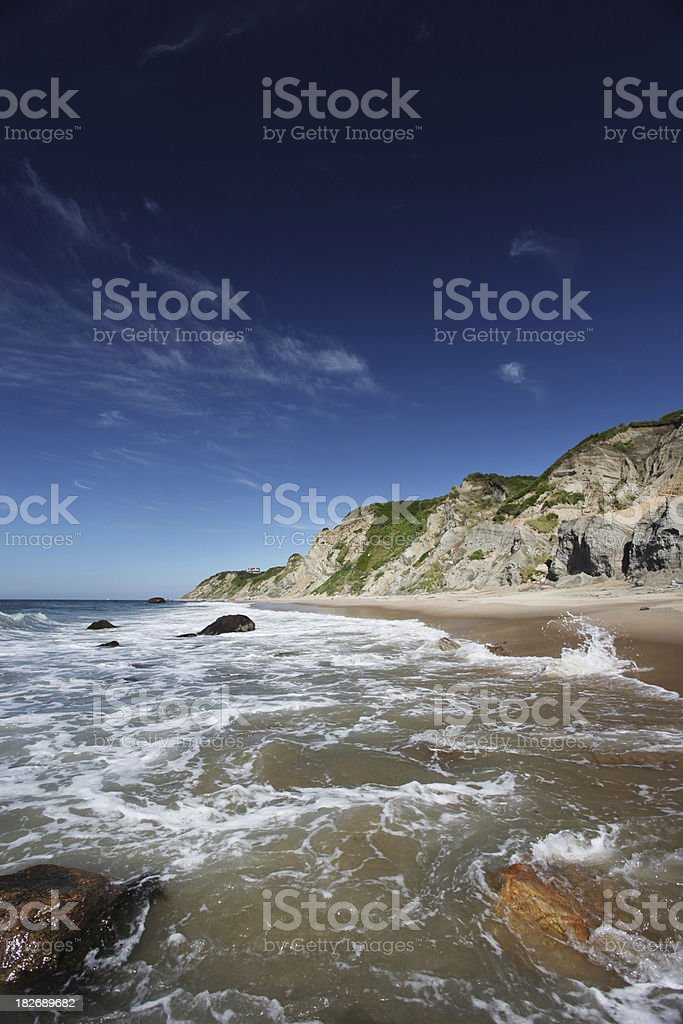 Tranquil beach after bluffs royalty-free stock photo