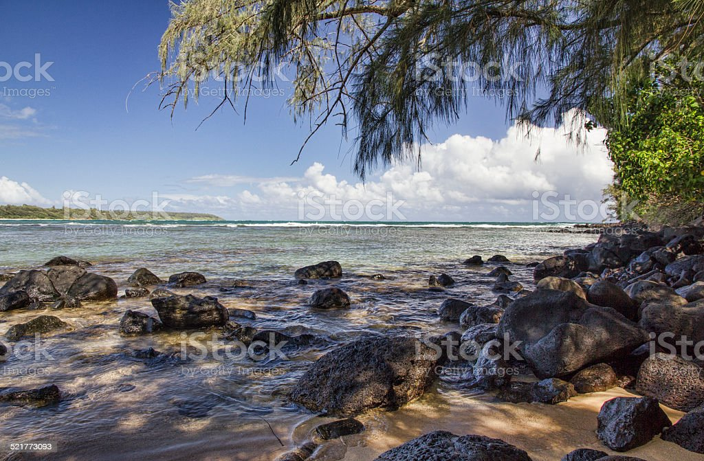 Tranquil Beach on Kauai Hawaii stock photo