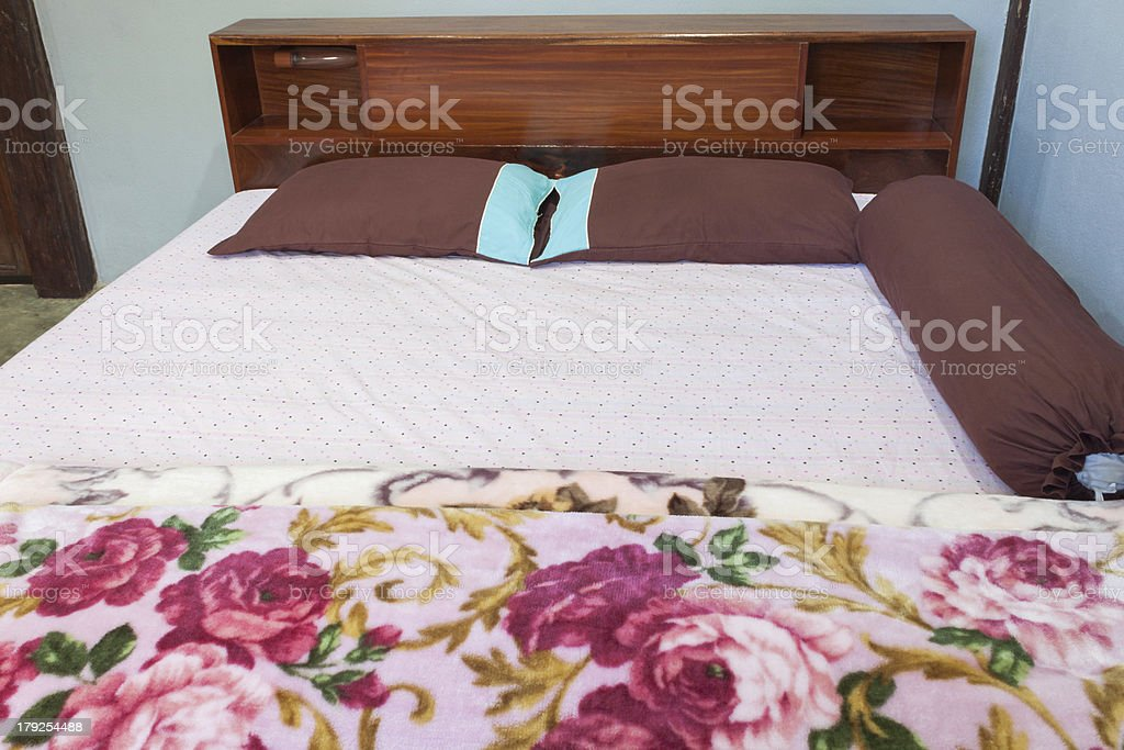 Tranquil bedroom with a double  hard wood bed royalty-free stock photo
