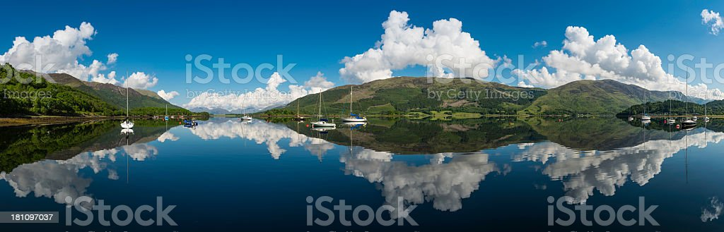 Tranquil blue lake sailing boats mountain clouds panorama Highlands Scotland royalty-free stock photo