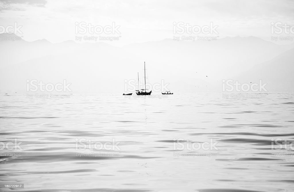 tranquil boats on water stock photo