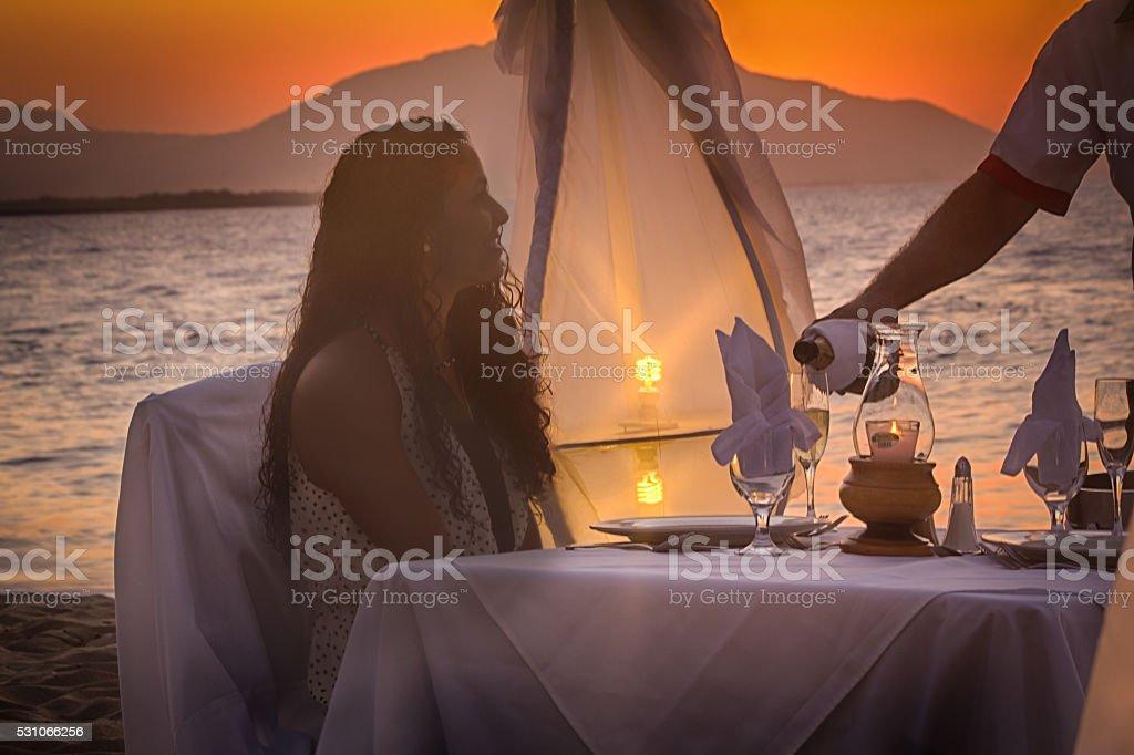 Tranquil Caribbean Dinner on the Beach stock photo