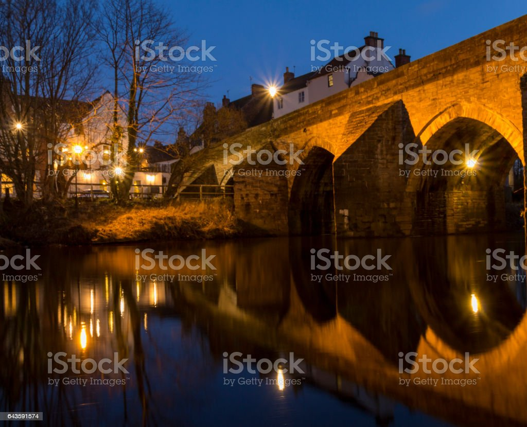 Tranquil City - Bridge Reflection in still waters stock photo