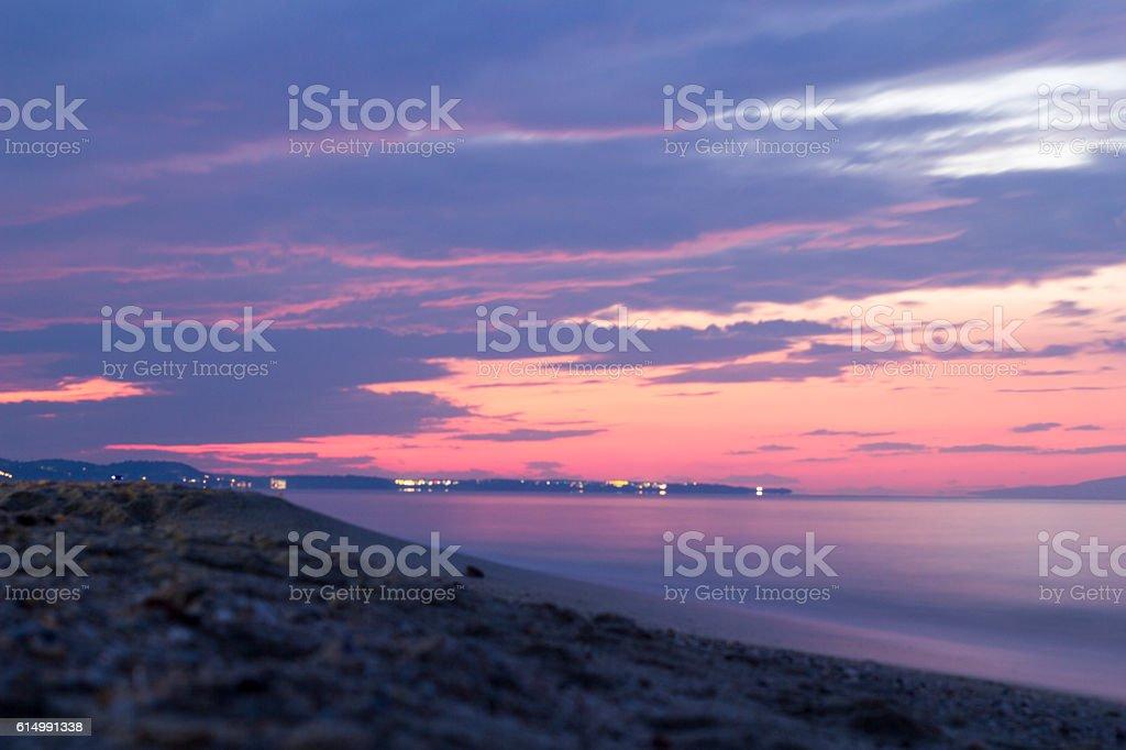 Tranquil colorful landscape of sea coast photographet at sunset. stock photo