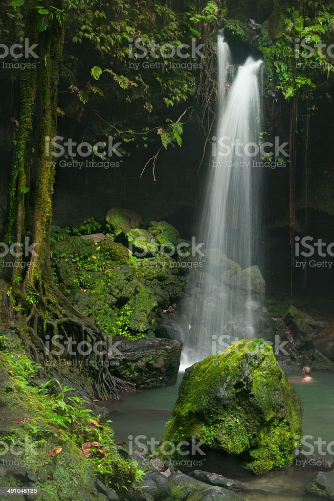 Tranquil Emerald Pool waterfall in Dominica stock photo