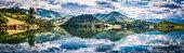 Tranquil lake reflecting green mountain shore Emigrant Lake panorama Oregon